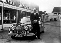 Mike with his Mark 1 Jaguar, VDU 881, at the Tourist Trophy Garage shortly before his death